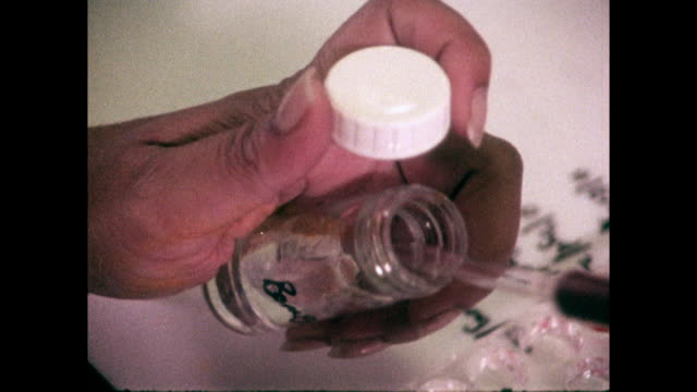 flu samples being tested in a laboratory; 1973 - medical equipment stock videos & royalty-free footage