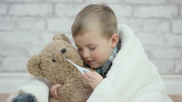flu season - teddy bear stock videos & royalty-free footage