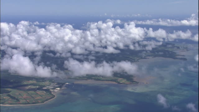 Fluffy clouds float above Iriomote Island of Okinawa, Japan.
