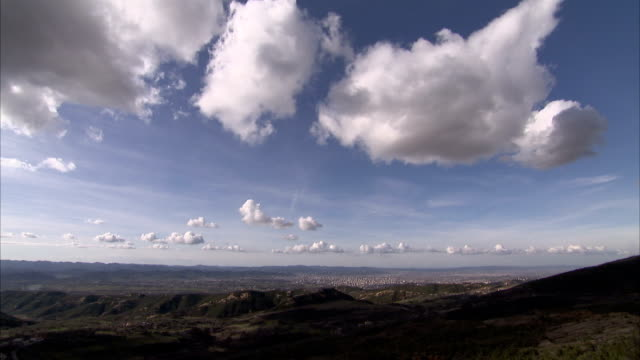 Fluffy clouds stretching out over the horizon Available in HD.
