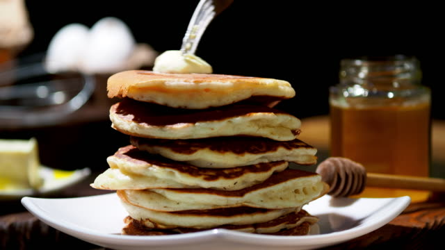 fluffy pancakes - stack of plates stock videos & royalty-free footage