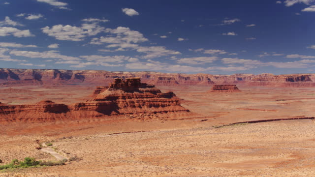 fluffy white clouds over monument valley - navajo reservation stock videos and b-roll footage