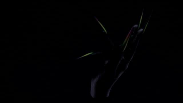 fluorescent fingernails on black hand in the dark - fluorescent stock videos & royalty-free footage
