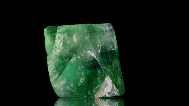 fluorit crystal turning on black - fluorite stock videos & royalty-free footage