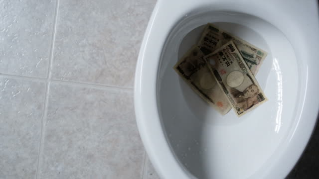 flushing money down the toilet - medium group of objects stock videos & royalty-free footage