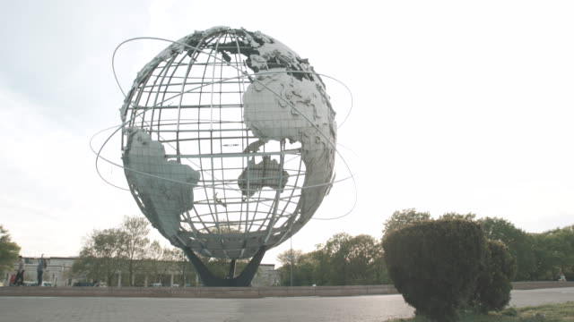 flushing park, queens nyc establishing shot - 4k - sunset - flushing meadows corona park stock videos and b-roll footage