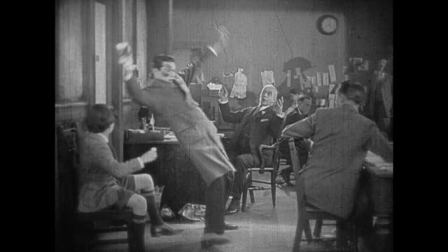 1925 flustered man spills ink, falls into editor's office and receives exciting assignment - 1925 stock videos & royalty-free footage