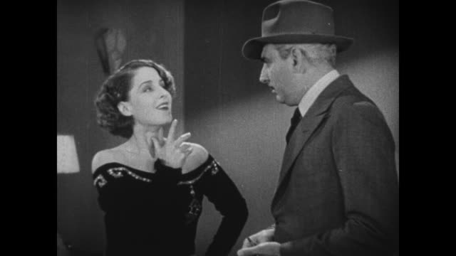 1931 Flustered woman (Norma Shearer) goes through jewelry in vanity and interrupts woman (Hedda Hopper) as she tries to ask questions before police inspector (Eddie Kane) arrives