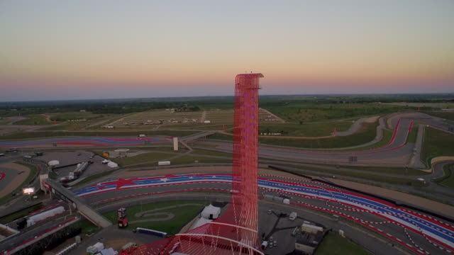 Fly around observation tower at Circuit of the Americas at sunset