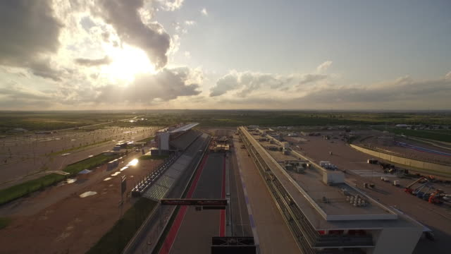 fly down straight at cota pan down to reveal xgames skateboarding park construction. - grand prix motor racing stock videos & royalty-free footage
