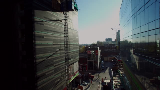 fly down street to reveal bell center - montréal stock videos & royalty-free footage