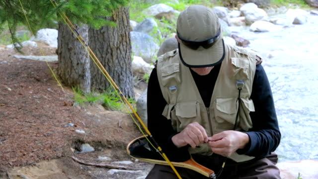 vidéos et rushes de fly fisherman liens lure - en individuel