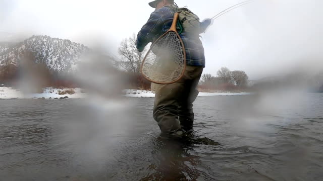 fly fishing in winter while snowing - fly fishing stock videos and b-roll footage