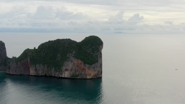 fly forward drone shot of phi phi le, phi phi islands, thailand - phi phi le stock videos & royalty-free footage