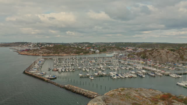 fly in over leisure boat harbour in gothenburg archipelago aerial over water - speed boat stock videos & royalty-free footage