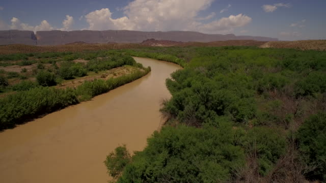 Fly low over Rio Grande River from Big Bend National Park Texas looking at Mexico 2