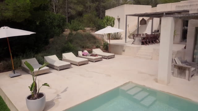fly over a mature man relaxing on a sun lounger - spain stock videos & royalty-free footage