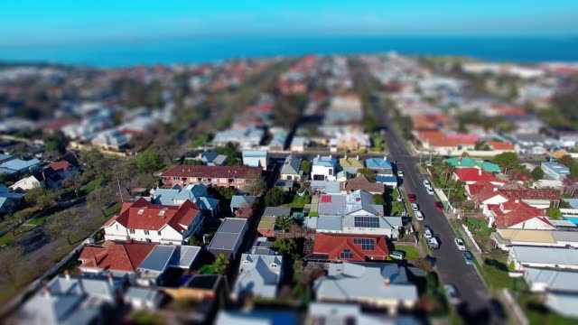 a fly over a typical coastal australian suburb. - david ewing stock-videos und b-roll-filmmaterial