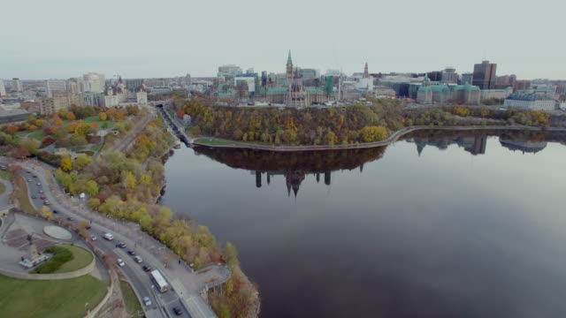 Fly over Alexandra bridge pan up to Canadian Parliament in Ottawa