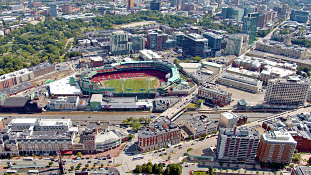 fly over business downtown, residential building, fenway park stadium, nature park. - boston massachusetts stock videos & royalty-free footage