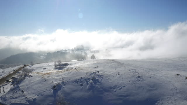 fly over cloud on mountain Saleve
