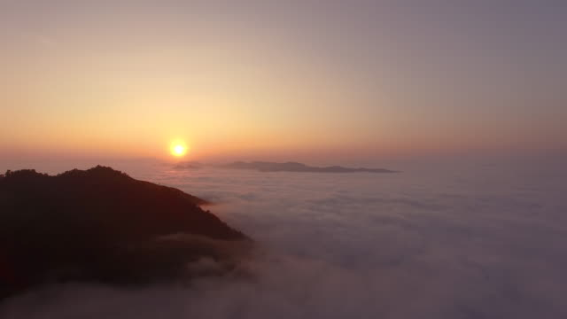 Fly over clouds during sunrise, Laos