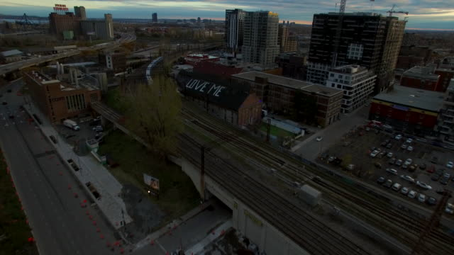 fly over graffiti / street art by train yard in montreal. - 操車場点の映像素材/bロール