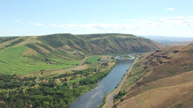 WS AERIAL Fly over hills and Clearwater River / Spalding, Idaho, United States
