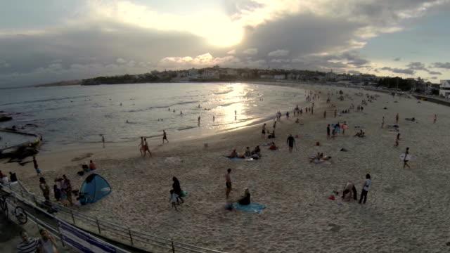 vídeos de stock, filmes e b-roll de fly over ice cream van to bondi beach - praia de bondi