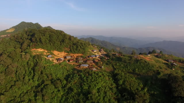 fly over lao akha village, laos - remote location stock videos & royalty-free footage