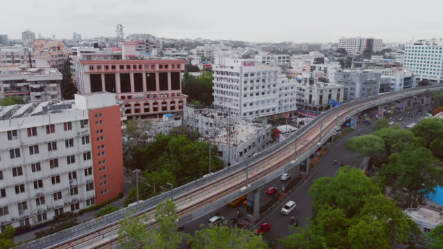 fly over metro trains and roads with intersections at rush hour in bustling south indian city - india stock videos & royalty-free footage
