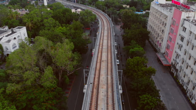 fly over metro trains and roads with intersections at rush hour in bustling south indian city - 4k resolution stock videos & royalty-free footage