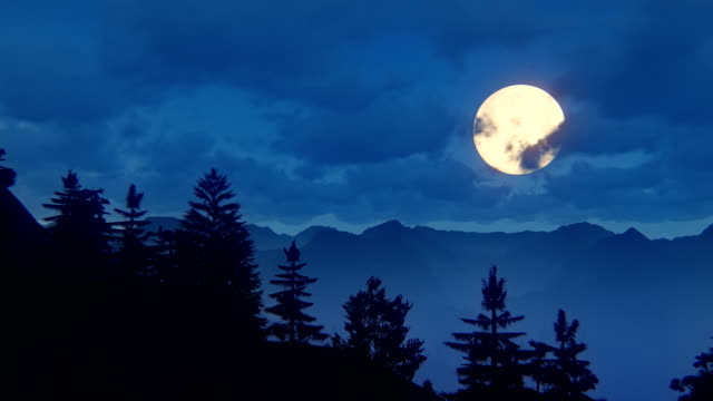 fly over mountain ridge with full moon - forest stock videos & royalty-free footage