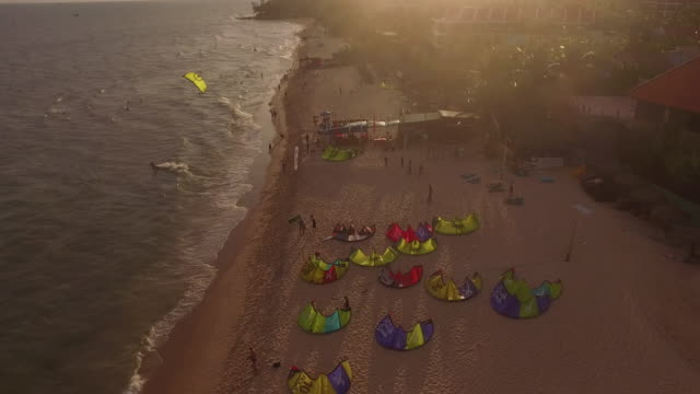 Fly over of a beautiful kite surf beautiful tropical beach