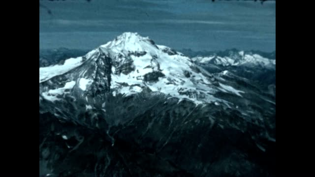 fly over of cascade mountains in washington state and glacier peak from archival film - washington state stock videos and b-roll footage