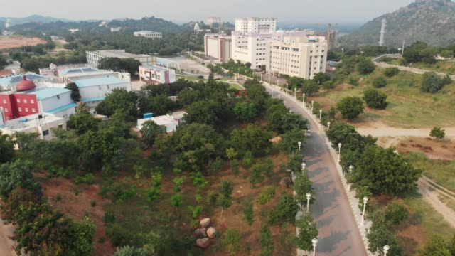 Fly Over Ramoji Film City, Hyderabad, India with hills, gardens and forest