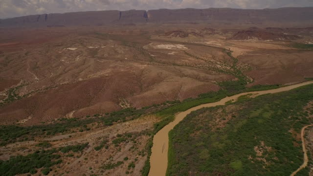Fly over Rio Grande River from Big Bend National Park Texas looking at Mexico