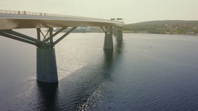 fly over sundsvall bridge in summer revealing whole bridge - coastal feature stock videos & royalty-free footage