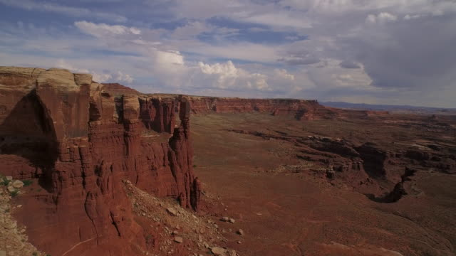 Fly over towering rock at Cannyonlands National Park Utah
