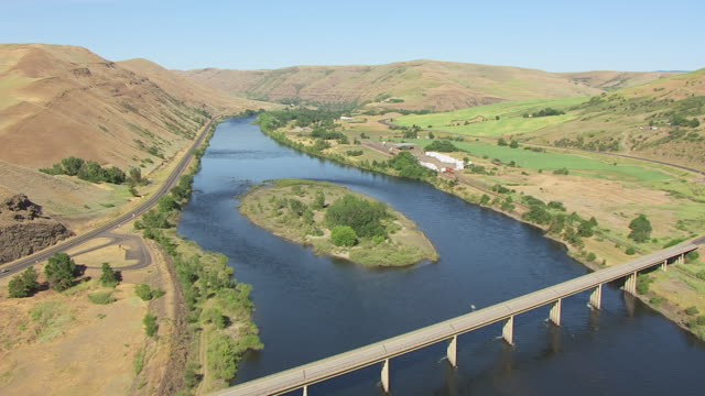 MS AERIAL Fly over train tracks and river / Spalding, Idaho, United States