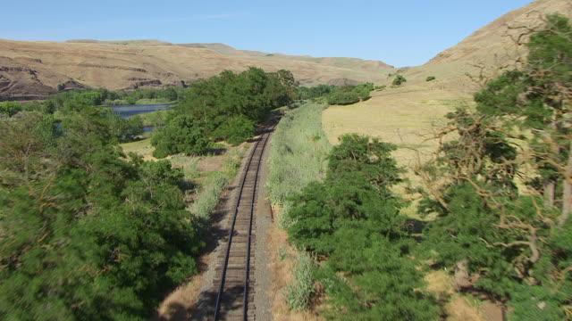 CU AERIAL HA Fly over train tracks / Spalding, Idaho, United States