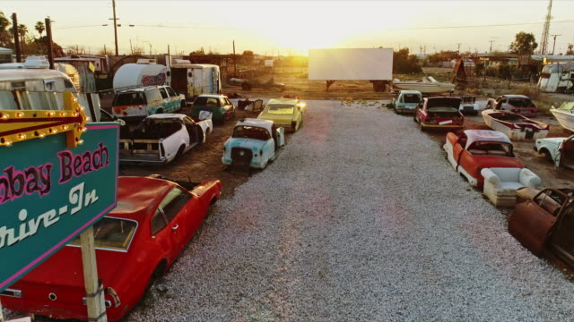 ws fly through bombay beach drive-in theater retro art installation featuring wrecked automobiles - installationskunst stock-videos und b-roll-filmmaterial