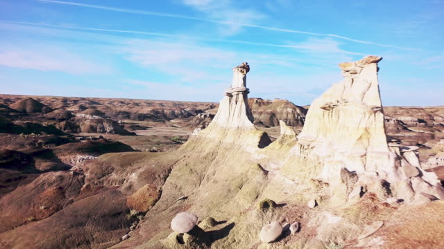 ms aerial fly through rock pinnacle formations - bisti badlands stock videos & royalty-free footage