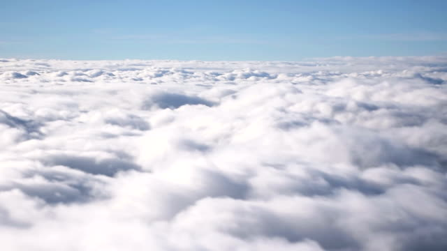 Fly through the sky with fluffy clouds.
