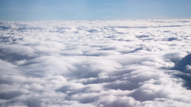 Fly through the sky with fluffy clouds