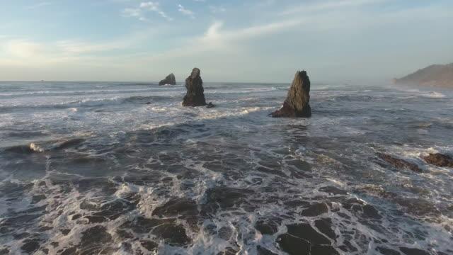 stockvideo's en b-roll-footage met fly through waves breaking on rocks half orbit ocean beach, aerial, 4k, 29s, 11of26, stock video sale - drone discoveries - drone aerial view - sale