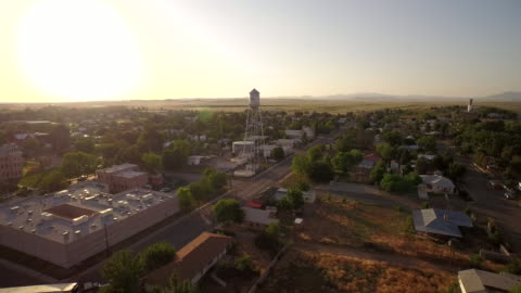 fly towards marfa water tower texas - rural scene stock videos & royalty-free footage