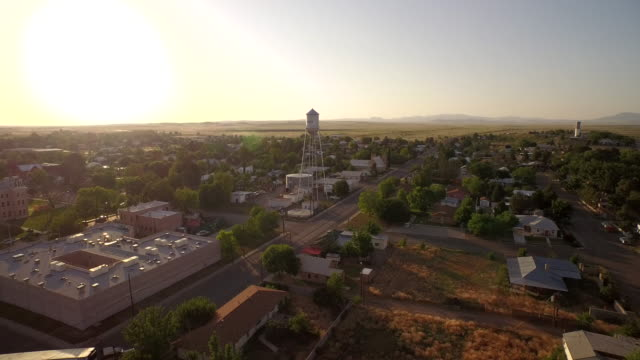 Fly towards Marfa water tower Texas