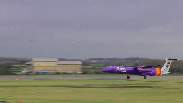 flybe aeroplane taking off at cardiff airport - taking off stock videos & royalty-free footage