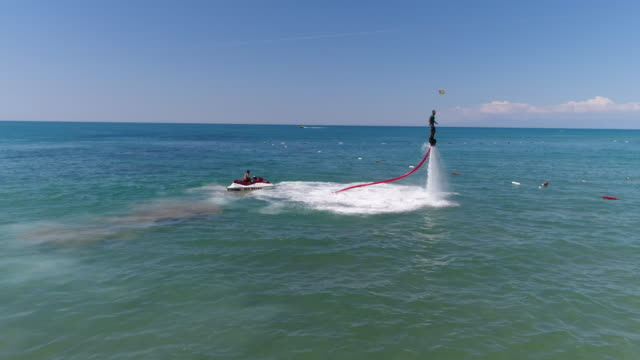 flyboard extreme sport adventure - hovering stock videos & royalty-free footage